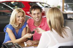 Couple buying new car Stock Photos