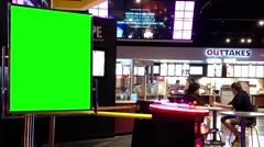 Green billboard for your ad beside video game Stock Footage