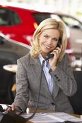 Woman working in car showroom Stock Photos