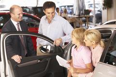 Family buying new car Stock Photos