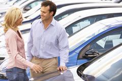 Couple buying new car - stock photo