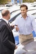 Man buying new car - stock photo