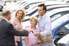 Family buying new car Stock Photos
