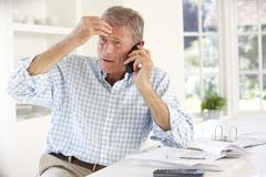 Retired man with household bills Stock Photos