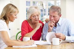 Retired couple with financial advisor Stock Photos