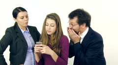 Parents fighting while teenager daughter is playing with cell phone slow motion Stock Footage