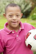 4 year old boy with Downs Syndrome - stock photo