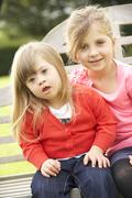 Girl with younger Downs Syndrome sister Stock Photos