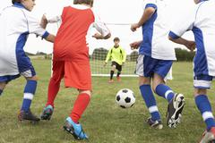 Stock Photo of Junior 5 a side teams playing football