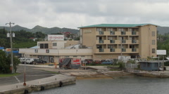 Boat Ramp and Apartment Building on the Island of PALAU Stock Footage