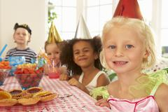 Young children eating at birthday party - stock photo