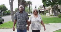 Sweet senior black couple walking together Stock Footage