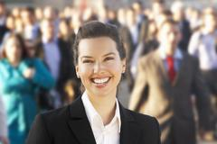 Female commuter in crowd Stock Photos