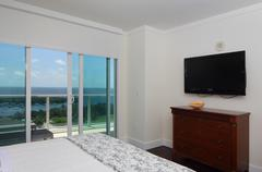 Comfortable bedroom with a view Stock Photos