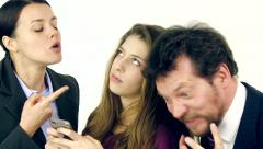 Two angry parents fighting while teenager daughter is playing with cell phone - stock footage