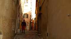 Man Walks Down Ally in Menton, FRANCE Stock Footage