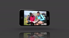 Media device screens showing outdoor adventure Stock Footage