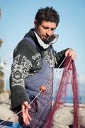 Fisherman with nets Stock Photos