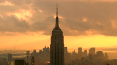 Time Lapse Empire State Building Yellow Orange Clowdy Stock Footage