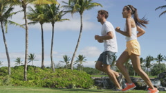 Running Young Couple In Sportswear Jogging In Park Stock Footage