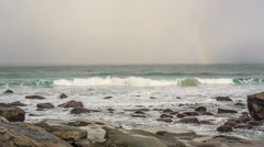 Rainbow over Utakleiv beach, Norway Stock Footage
