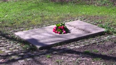 Karen Blixen's grave on a sunny spring day, and her 130th birthday Stock Footage