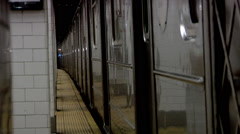 Train Seventh Avenue MTA Local Subway Station Stops Passengers get off Stock Footage