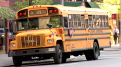 School Bus Blinking Lights unloading students street corner New York Stock Footage