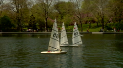 Model sailboats on the Conservatory Water, Central Park, New York. Stock Footage
