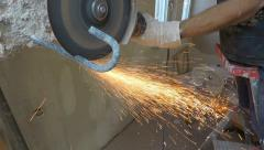 Cutting metal with an angle grinder Stock Footage