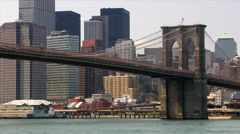 Gorgeous color  View of skyline and Brooklyn bridge over East River in New York Stock Footage