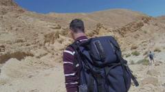 Stock Video Footage of Hiker in rocky desert