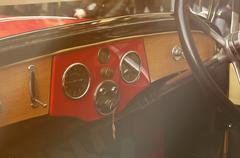 Driver's cockpit of a classic car. Stock Photos