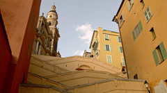 Striking Historic Neighborhood and Church Steeple in MENTON, FRANCE Stock Footage