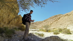Backpacker in mountains Stock Footage