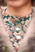 Original glass buttons on a dress Stock Photos