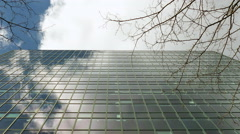 Glass building cloud reflection zoom-out, time lapse Stock Footage