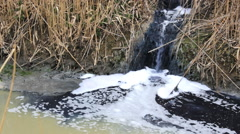 Toxic  Liquid industrial Factory toxic waste in river - stock footage