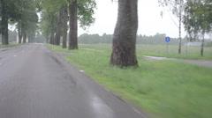Rain fall on car automobile windscreen drive on road Stock Footage