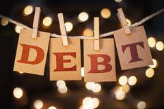 Debt Concept Clipped Cards and Lights Stock Photos