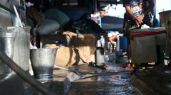 Man shutting water pipe by the street canal in Mumbai. Stock Footage