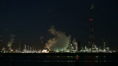 Refinery Behind River At Night Stock Footage