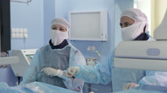 Angiographic sugery: two surgeons during the surgery Stock Footage