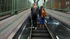 Entering and exiting escalator section, people on the way Stock Footage