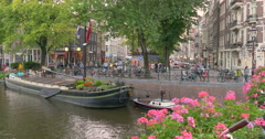 Houseboat or house boat museum, Amsterdam canal, canals, Netherlands Stock Footage