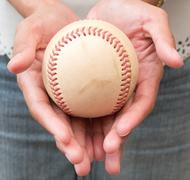 Close-up of Girl's Hand Holding A Well Used Baseball Stock Photos