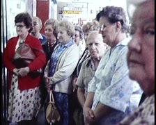 PUBLIC WATCHING MELB CUP THROUGH SHOP WINDOWS (1980) Stock Footage