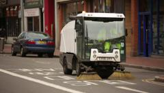 Road sweeper in England Stock Footage