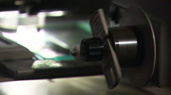 Close up newspaper microfiche reel turns Stock Footage