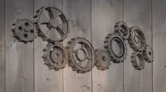 Cogs and wheels turning on wooden background Stock Footage